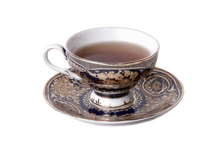 Teacup full of tea on white background Standard-Bild