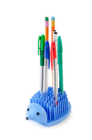 pencil holder: Holder full of pen and pencil isolated on white