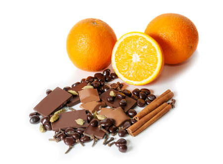 orange peel clove: Chocolate, orange, spices isolated on white. Selective focus