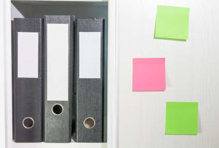 Folders for documents on a book shelf photo