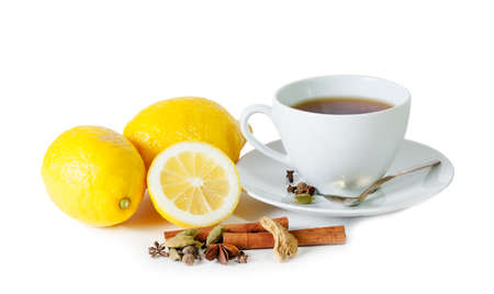 lemon: Black tea with lemon and spices isolated on white Stock Photo