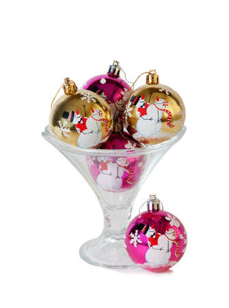 ice cream glass: Christmas balls in the ice cream glass bowl isolated on white