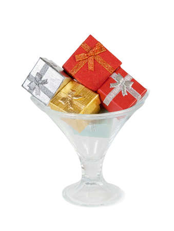 ice cream glass: Gift boxes in the ice cream glass bowl on white background