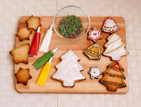Preparing christmas cookies Standard-Bild