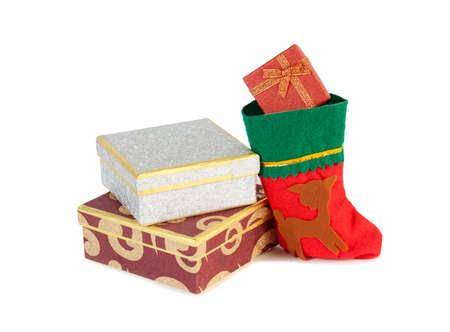 botas de navidad: Regalos de Navidad y el calcetín de Navidad aislado en blanco Foto de archivo