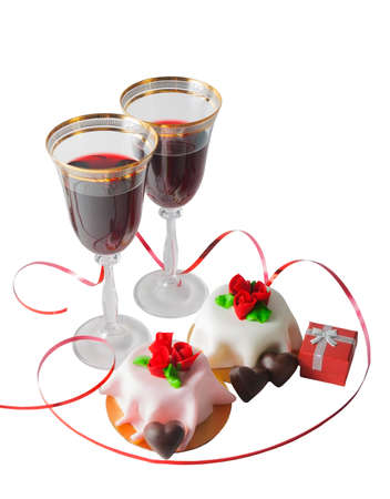 wine gift: Glasses of red wine, gift box and cake with red marzipan roses isolated on white