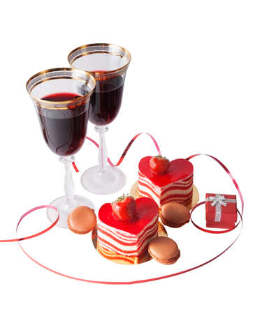 wine gift: Glasses of red wine, gift box and heart shape cake isolated on white Stock Photo