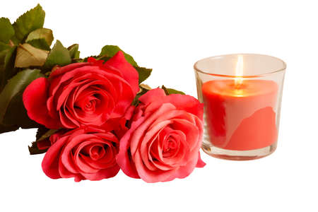 fire flower: Pink roses and candle isolated