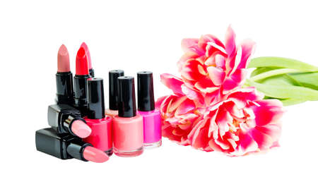 Group of colorful lipsticks, nail polishes and tulips isolated on white background