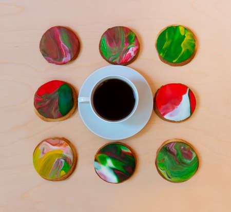 Cup of coffee and homemade cookies decorated with fondant Stock Photo