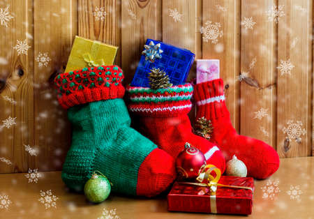 Christmas stockings on wooden background