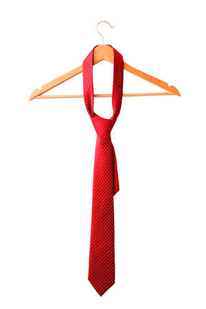 Red male tie hanging on the rack. Isolated on white background. Stock Photo
