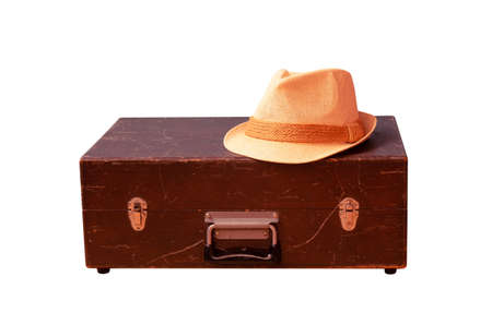 Vintage wooden suitcase and hat. Travel concept. Isolated on white. Standard-Bild