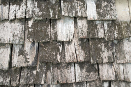 Traditional wooden roof tile of old house photo