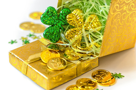 paddys: Green and Gold Shamrocks with gold coins Stock Photo