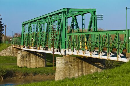 Train bridge on river Koros photo