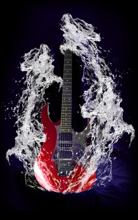 Red electric metal guitar surrounded by water splashs  Stock Photo