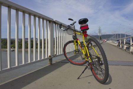 Yellow mountain bike standing on the bridge photo