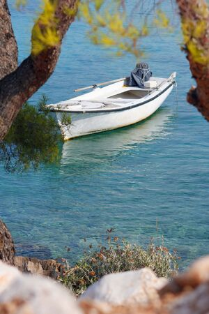 Small motor boat on the silent sea Stock Photo