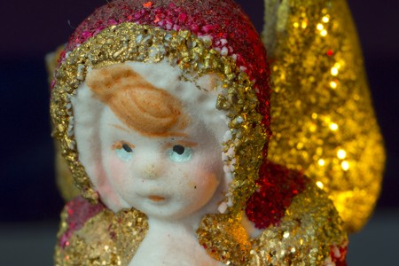 Red and gold christmas angel with golden stars