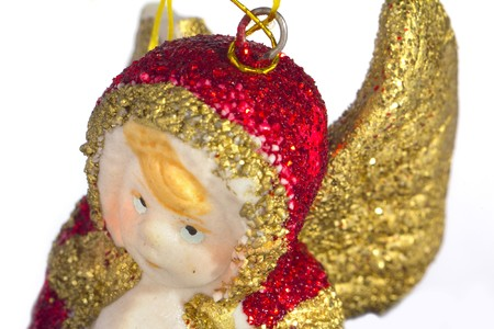Red and gold christmas angel isolated on white