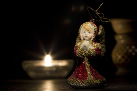 Red and golden christmas angel with candles in the night   photo