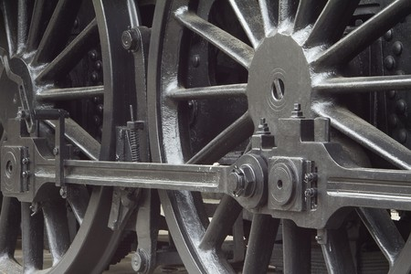 railway history: Closeup of vintage steam engines black, iron wheel Stock Photo