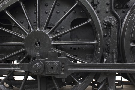 old train: Closeup of vintage steam engines black, iron wheel Stock Photo