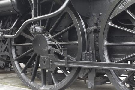 Closeup of vintage steam engines black, iron wheel Stock Photo