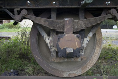 The rusty wheels of an abandoned, old train
