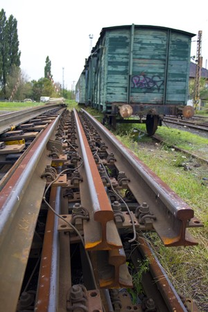 Rusty rails and abandoned, old rail carriage Stock Photo - 7939976