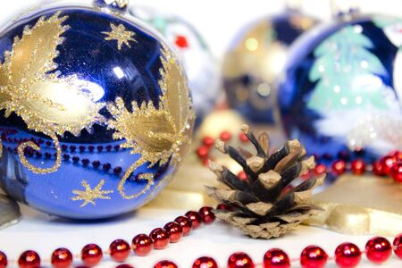 Hand painted christmas balls, decorated with ribbon, and christmas items, high key photo