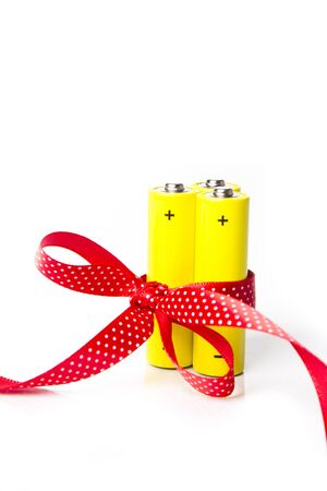 Yellow battery in ribbon. Isolated on white