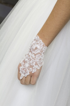 The hand of a young bride on the wedding clothe Stock Photo