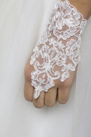 clothe: The hand of a young bride on the wedding clothe Stock Photo