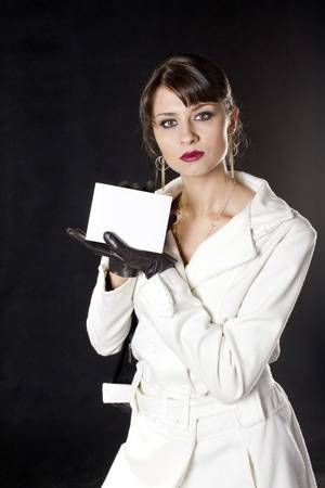 Young woman holding a white box in her hand Stock Photo