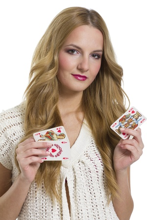 Young woman holding heart playing card in valentines day, on white background