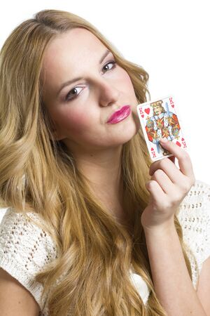 Young woman holding heart playing card in valentines day, on white background photo