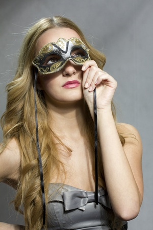 Young woman holding a venecian mask at valentine photo