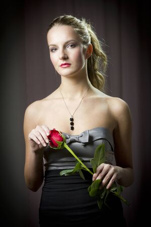 Attractive woman holding a rose on Valentine's day, Stock Photo - 15492328