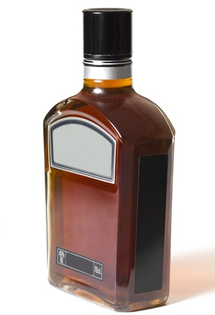 Full bottle of whiskey or brandy on white background