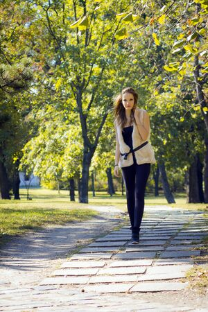 Young, beautiful woman in the city park Stock Photo