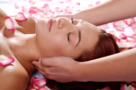 massage face: massage for a young woman