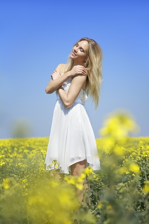young woman enjoying sun in spring time