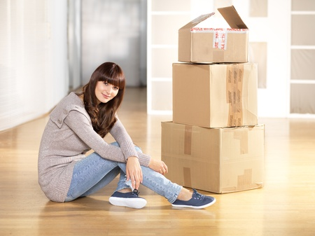 moved: Young woman moved to new apartment