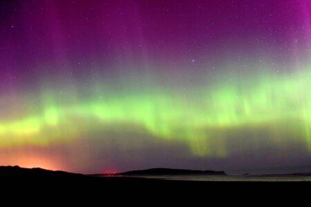 The brilliant display of Aurora Australis in Oreti Beach, near Invercargill city. 免版税图像