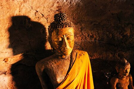 Old Buddha Wat Aow Noi in Cave photo