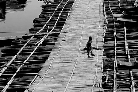 longest: Two boy on Longest bamboo bridge in Thailand, Sangkhlaburi District, Kanchanaburi,