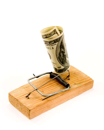 booby trap: dollar banknote in a mousetrap as illustration of your money security or of the decoy, bait, artifice