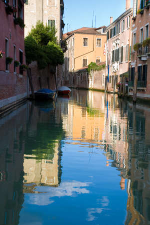 Venice canal and houses reflection in summer bright day, Italy photo